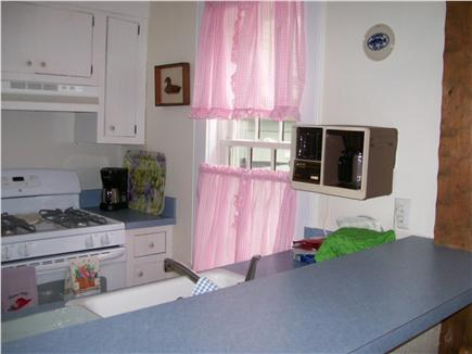 New Seabury, Maushop Village,Mashpee Cape Cod vacation rental - Gally Kitchen, new stove, micro-wave &white sink. Eat in counter.