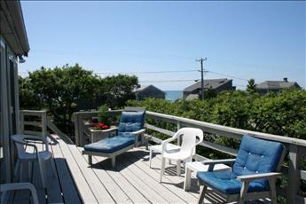 Eastham Cape Cod vacation rental - Lounge on the wrap deck; enjoy sunshine, views & sunset.