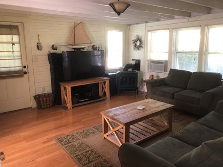 Brewster Cape Cod vacation rental - Sunny living room with TV, AC