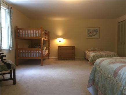Orleans Cape Cod vacation rental - Large second floor bedroom- three twins and one full size bed.