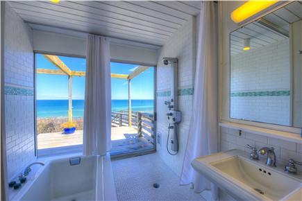 East Sandwich Cape Cod vacation rental - Bathroom provides sunken tub and sliding doors to deck.