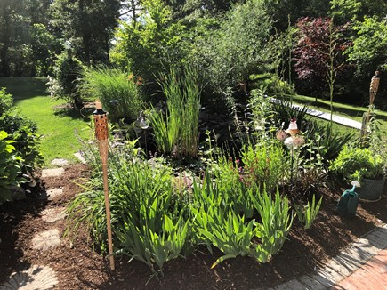 Dennis Cape Cod vacation rental - Patio and Koi pond with plantings