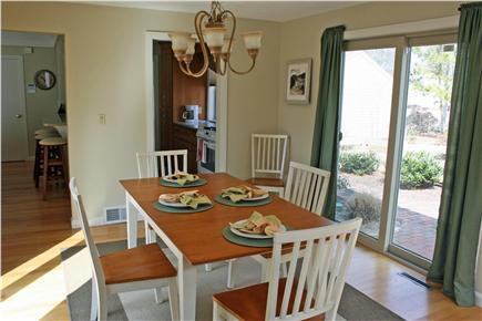 New Seabury, Mashpee New Seabury vacation rental - Full-sized dining room with view of pool.