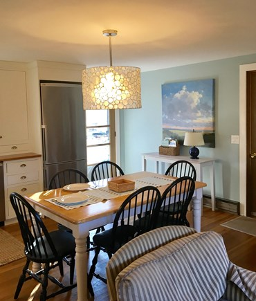 Eastham Cape Cod vacation rental - Open plan dining area leads to deck with outdoor dining.