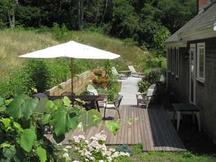 Truro Cape Cod vacation rental - Back yard deck for barbeque, dining, sun and outdoor shower