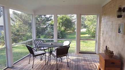 Truro Cape Cod vacation rental - Covered screen porch for outdoor living and dining