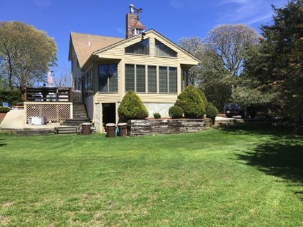 Dennisport Cape Cod vacation rental - Large, private yard borders conservation land.
