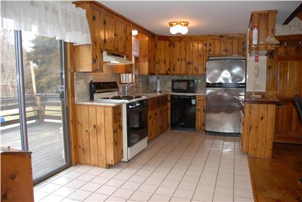 Dennisport Cape Cod vacation rental - Bright, fully equipped kitchen leads outside to expansive deck.