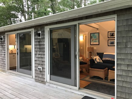 Orleans Cape Cod vacation rental - Main room has 2 sliding doors that open to the deck and the pond.