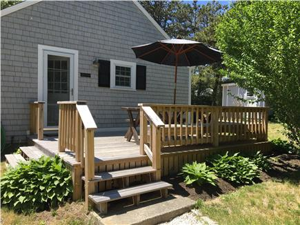 South Chatham - Forest Beach Cape Cod vacation rental - Outside deck with large picnic table and plenty of seating.