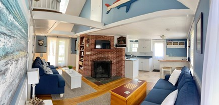 South Chatham - Forest Beach Cape Cod vacation rental - Living room looking toward backyard w/ skylight, fireplace & tv.