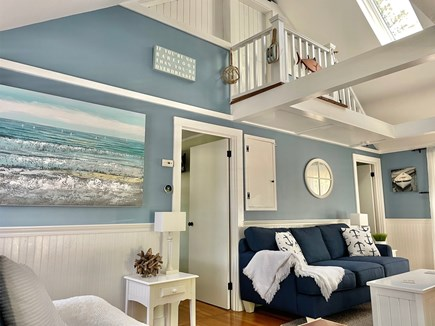 South Chatham - Forest Beach Cape Cod vacation rental - Living room w/new couches showing bedroom doors & high ceilings.