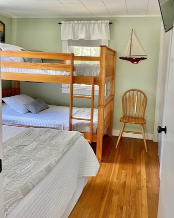 South Chatham - Forest Beach Cape Cod vacation rental - Bedroom with Full Bed and Bunk Beds -flat screen TV w/ DVD