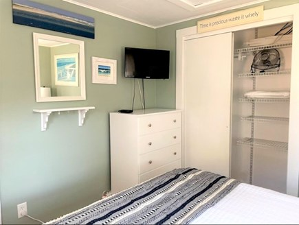 South Chatham - Forest Beach Cape Cod vacation rental - Master Bedroom alternate view of flat screen TV and closet.