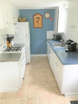 South Chatham - Forest Beach Cape Cod vacation rental - Kitchen fully stocked w/ new dishwasher, gas stove & microwave.