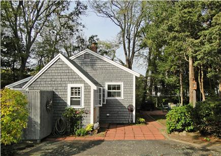 West Dennis Cape Cod vacation rental - Side view of house, showing outdoor shower and back yard