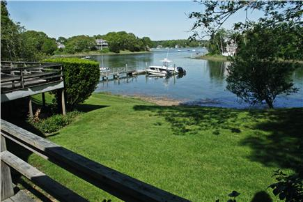 Orleans Cape Cod vacation rental - View of part of the yard with the river and dock