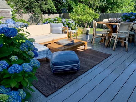 Barnstable Cape Cod vacation rental - Deck for dining and gathering nestled in beautiful garden.