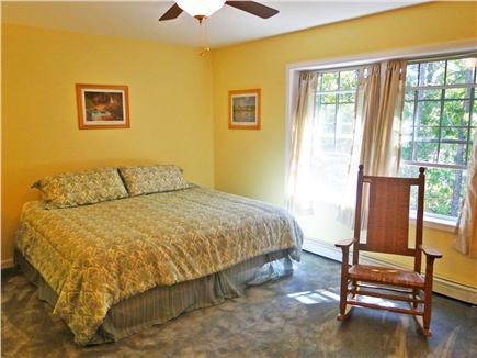 Brewster Cape Cod vacation rental - Large bright master bedroom, king bed, TV, bathroom & ceiling fan