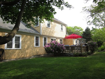Brewster Cape Cod vacation rental - Private backyard with gardens, bird feeders, & a furnished deck.
