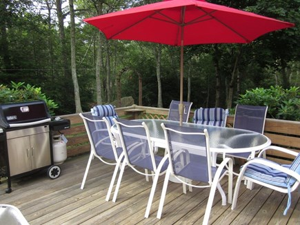 Brewster Cape Cod vacation rental - Large patio table on deck seats 8 adults. Large Weber Grill.