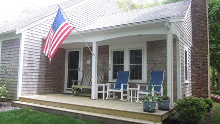 Brewster Cape Cod vacation rental - Front patio with two rocking chairs and a two person glider.