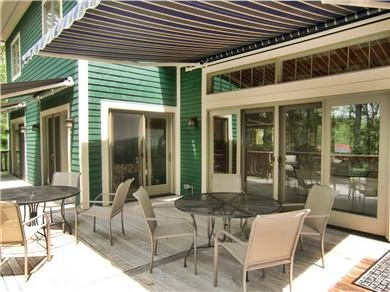 9 Pond Road, Orleans Cape Cod vacation rental - Deck - Gas grill, lounge chairs, table & benches off main level