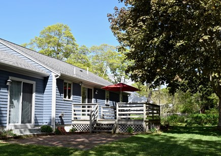 Harwich Cape Cod vacation rental - Back yard with deck