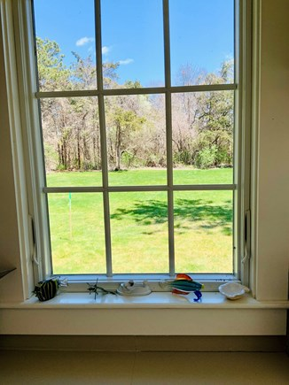 Brewster Historic District Cape Cod vacation rental - Kitchen window overlooking the spacious back yard.