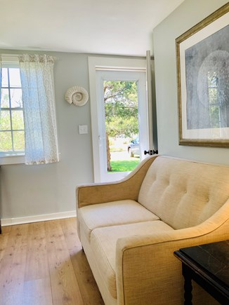 Brewster Historic District Cape Cod vacation rental - Loveseat and front door.