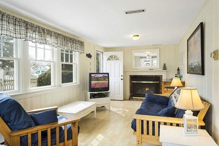 Falmouth - Maravista Cape Cod vacation rental - Living room has TV, fireplace and queen futon