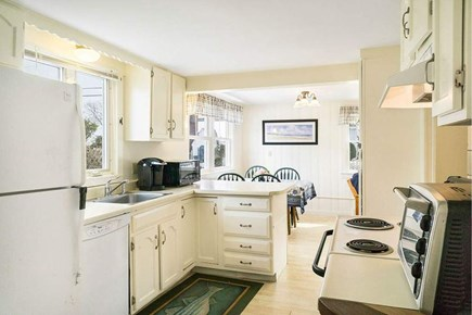 Falmouth - Maravista Cape Cod vacation rental - Kitchen is open to dining area with views of Great Bay