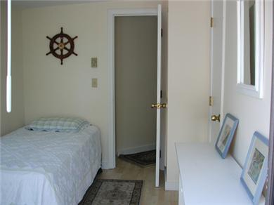 Falmouth - Maravista Cape Cod vacation rental - Twin bedroom on first floor has glass sliding doors to patio