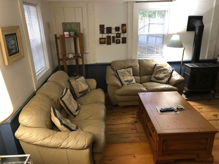 Dennis Village, Scargo Lake Cape Cod vacation rental - Living room of Cape Cod cottage with propane heater stove
