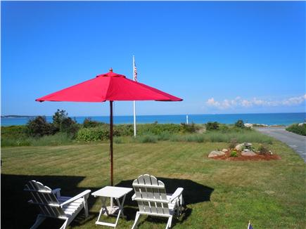 Falmouth Cape Cod vacation rental - Front lawn and ocean ,beach is at end of driveway
