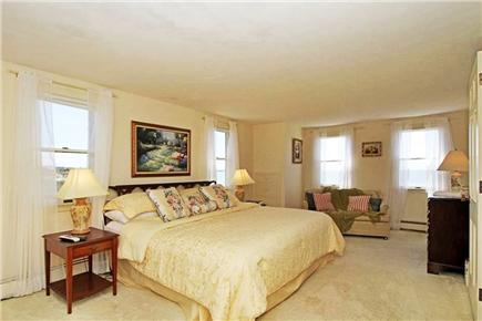 Falmouth Cape Cod vacation rental - Master Bedroom , king size bed with views of ocean & woodlands