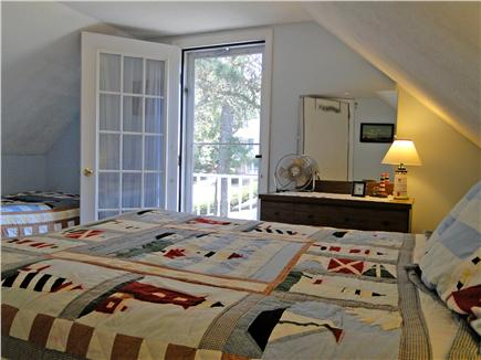 Harwich Cape Cod vacation rental - Master bedroom with queen, twin and lovely deck