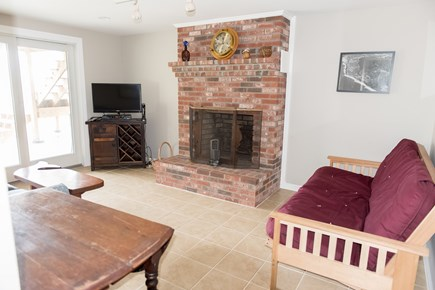 Brewster Cape Cod vacation rental - Family rec style room with TV and slider out to backyard