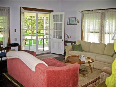 Plymouth, Manomet Bluffs MA vacation rental - Spacious living with double doors opening on to the front porch .