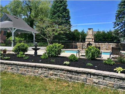 Dennis Cape Cod vacation rental - View of backyard pool and coverd pergola