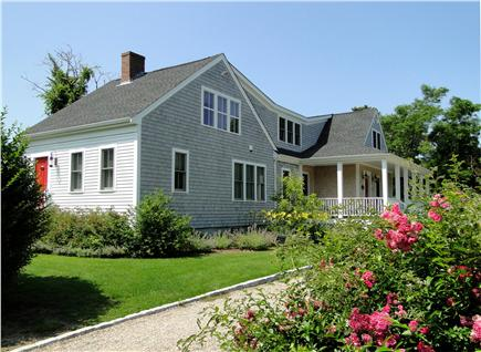 Dennis Port Cape Cod vacation rental - Front of house and wrap around farmers porch overlooking the pool
