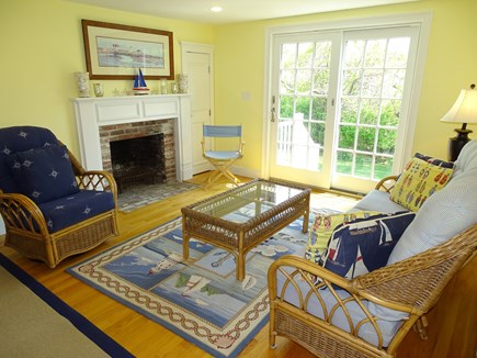 Dennis Port Cape Cod vacation rental - Family room with fire place and french doors to deck