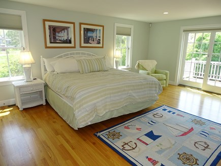 Dennis Port Cape Cod vacation rental - Master bedroom 1st floor king size bed with french doors to deck