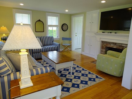 Dennis Port Cape Cod vacation rental - Spacious living room with fire place and large flat screen TV