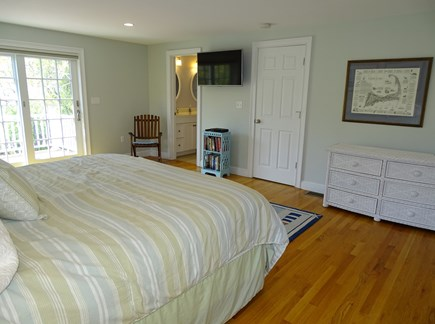 Dennis Port Cape Cod vacation rental - Master bedroom showing TV, private bath with glass shower