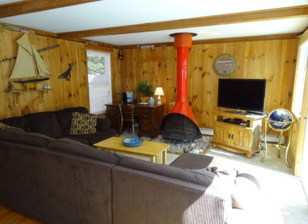 Wellfleet Cape Cod vacation rental - Living room with TV, two sliders to atrium / deck
