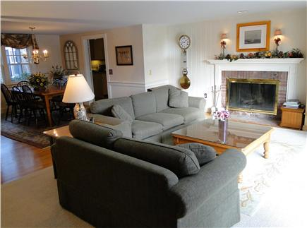 Brewster Cape Cod vacation rental - Living room with sectional, view towards dining room