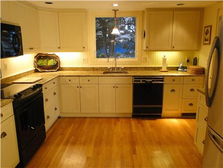 Brewster Cape Cod vacation rental - Modern Kitchen with stainless steel fridge, wood floors