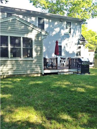 Mashpee, Popponesset Cape Cod vacation rental - Back of house. Deck,  gas grill, private outdoor shower far right