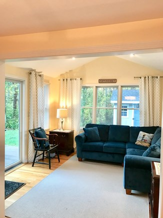 Mashpee, Popponesset Cape Cod vacation rental - Sunroom with exit to the deck overlooking conservation land